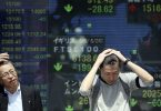 Asian stock markets react to Trump's criticism of US Federal Reserve
