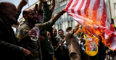Iranians celebrate 40-yrs of Islamic revolution, burn US flags, chant death to Israel