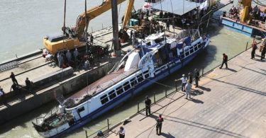 Rescue team recover bodies as sunken tour boat is raised in Hungary