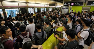 Demonstrators block train services in Hong Kong as violent protests continue