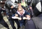 Russian police arresting protesters at Pushkin Square in Moscow