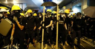 Trains, planes grounded in Hong Kong as violent protests deepen