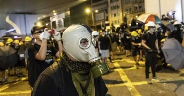 Pro-democracy protesters in Hong Kong throw Monday morning train travels into chaos