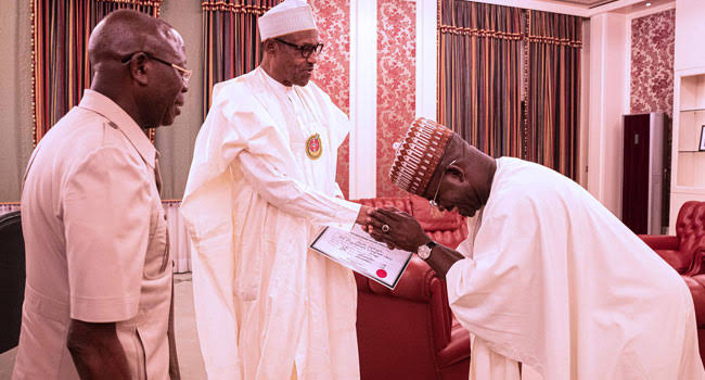 All smiles as Bello presents certificate of return to Buhari