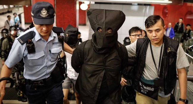 Police arrest 6 pro-democracy legislators in Hong Kong