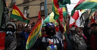 Bolivia policemen join protest against Morales