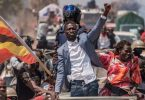 Uganda military court charges 49 aides of Bobi Wine with illegal possession of ammunition