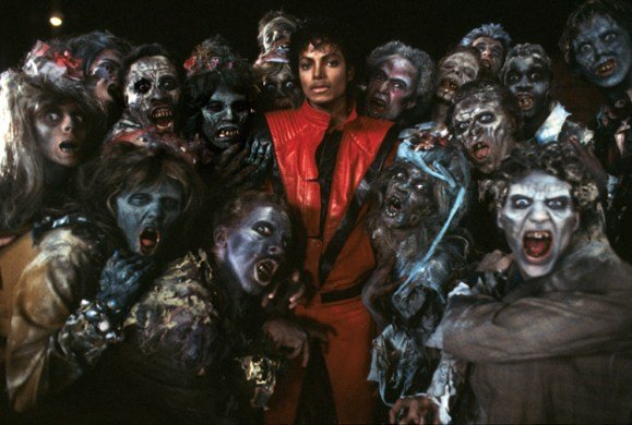 12 Thrilling Facts About Michael Jackson s  Thriller      Rolling Stone Michael Jackson and zombies on the set of Thriller