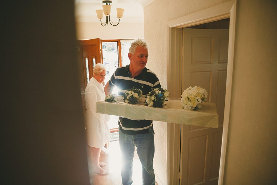 flowers being delivered on the morning of a wedding