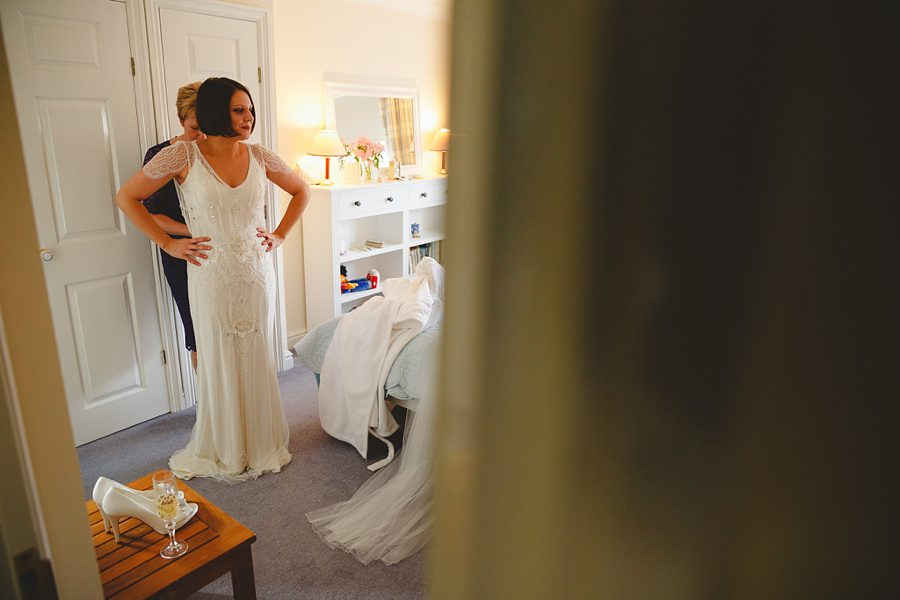 bride putting on her wedding dress from the mews in bristol