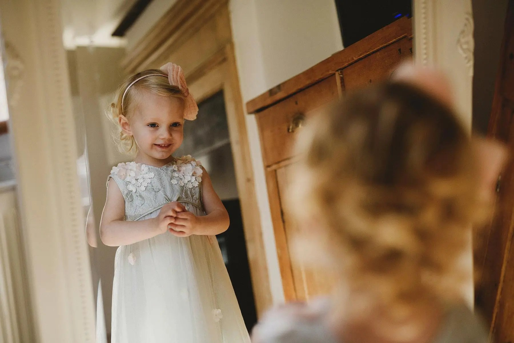 flower girl looking in the mirror