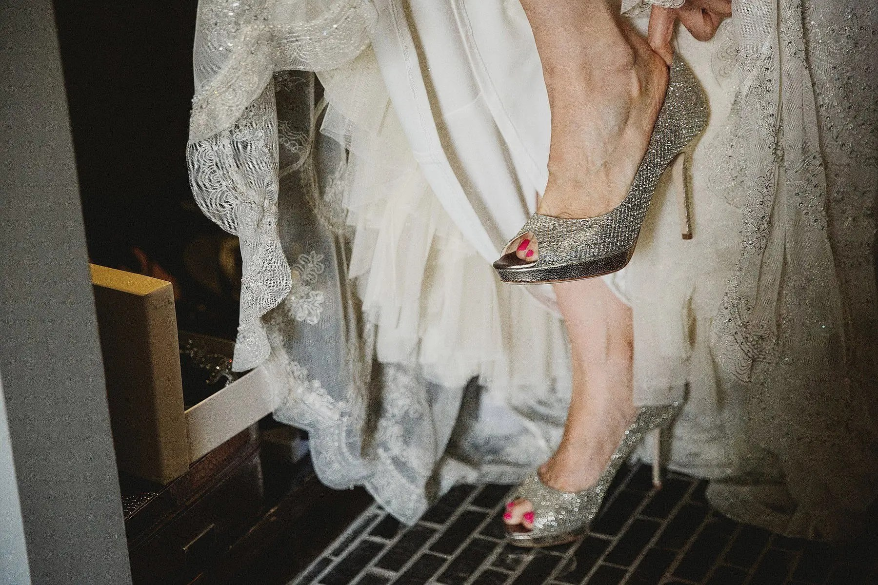bride wearing jimmy choos