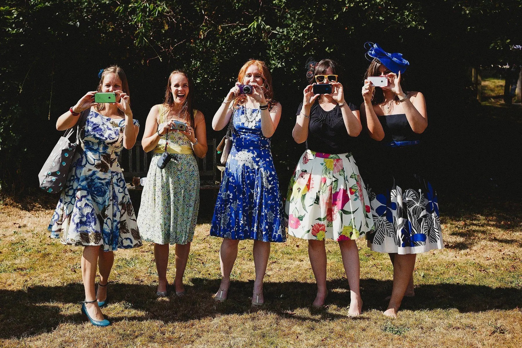 girls taking pictures at a wedding