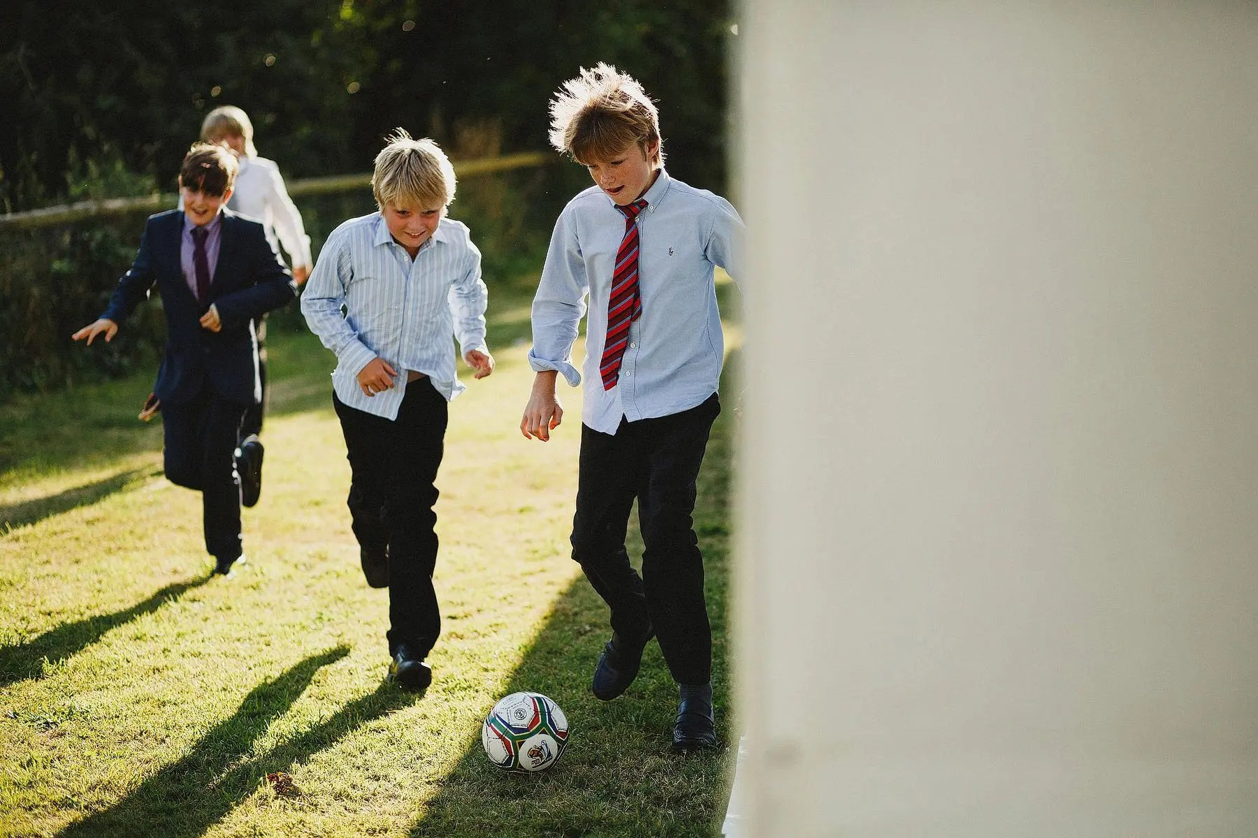 boys playing football at a wedding