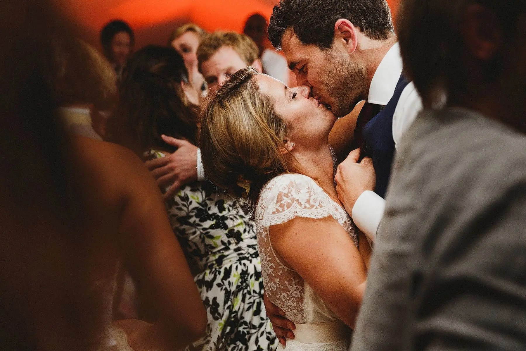 kissing on the dancefloor at a wedding