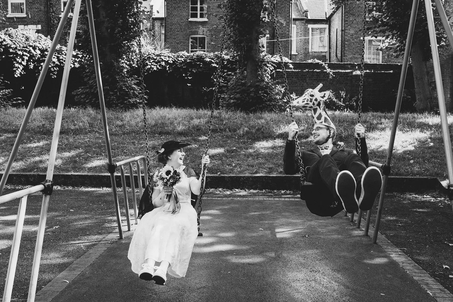 bride and groom on swings