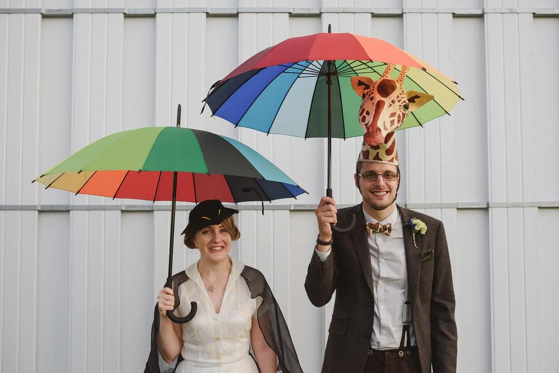 alternative portraits at a wedding using rainbow umbrellas