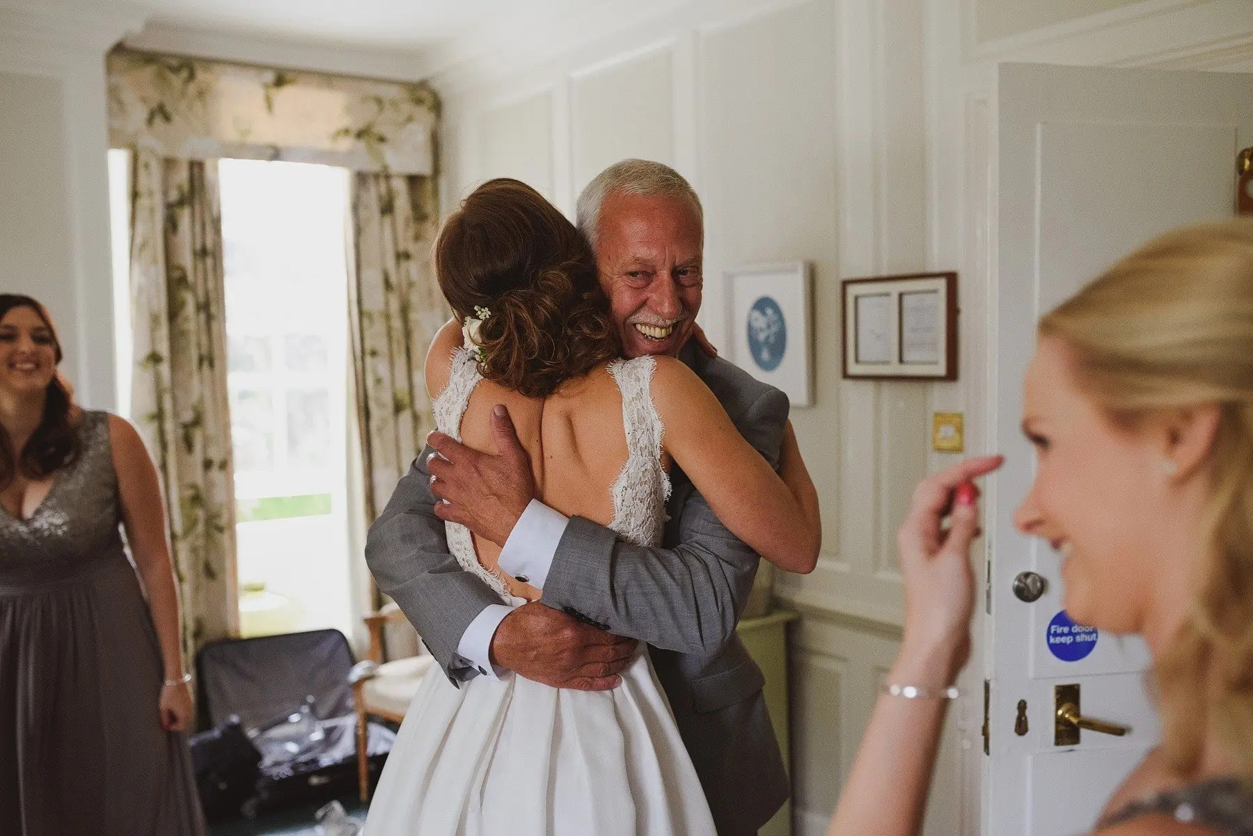 daughter hugs dad at the rectory in crudwell