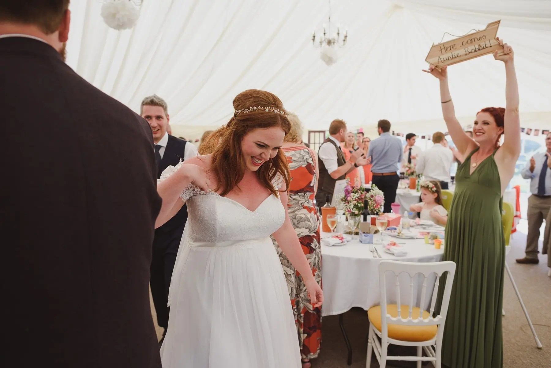 bride entering marquee at wedding