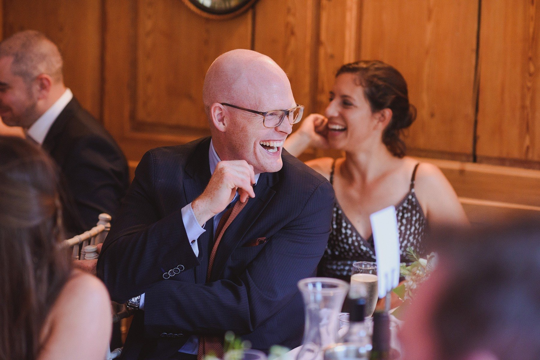 guests laughing at speeches at the rectory wedding