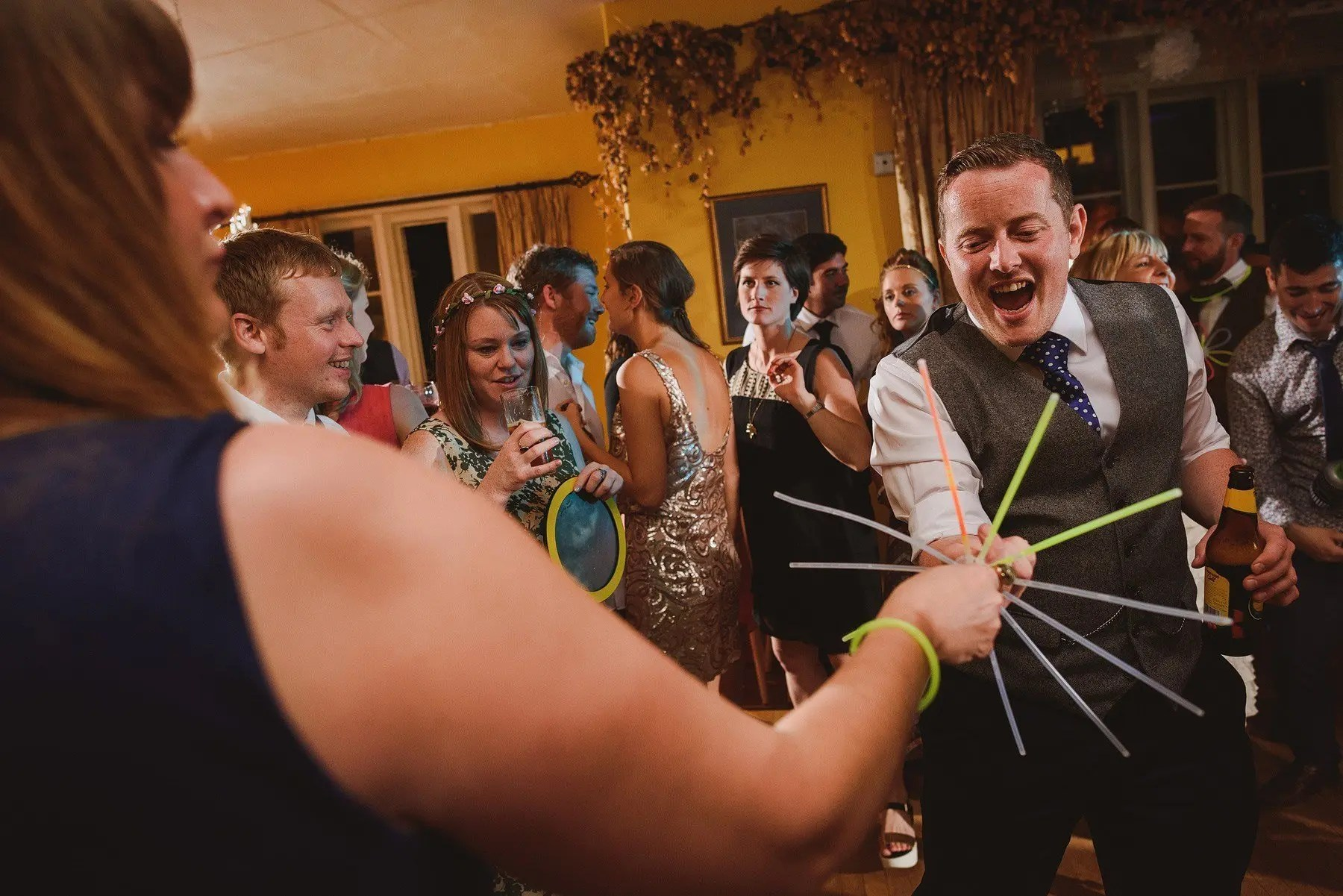 glowsticks on the dancefloor at a wedding
