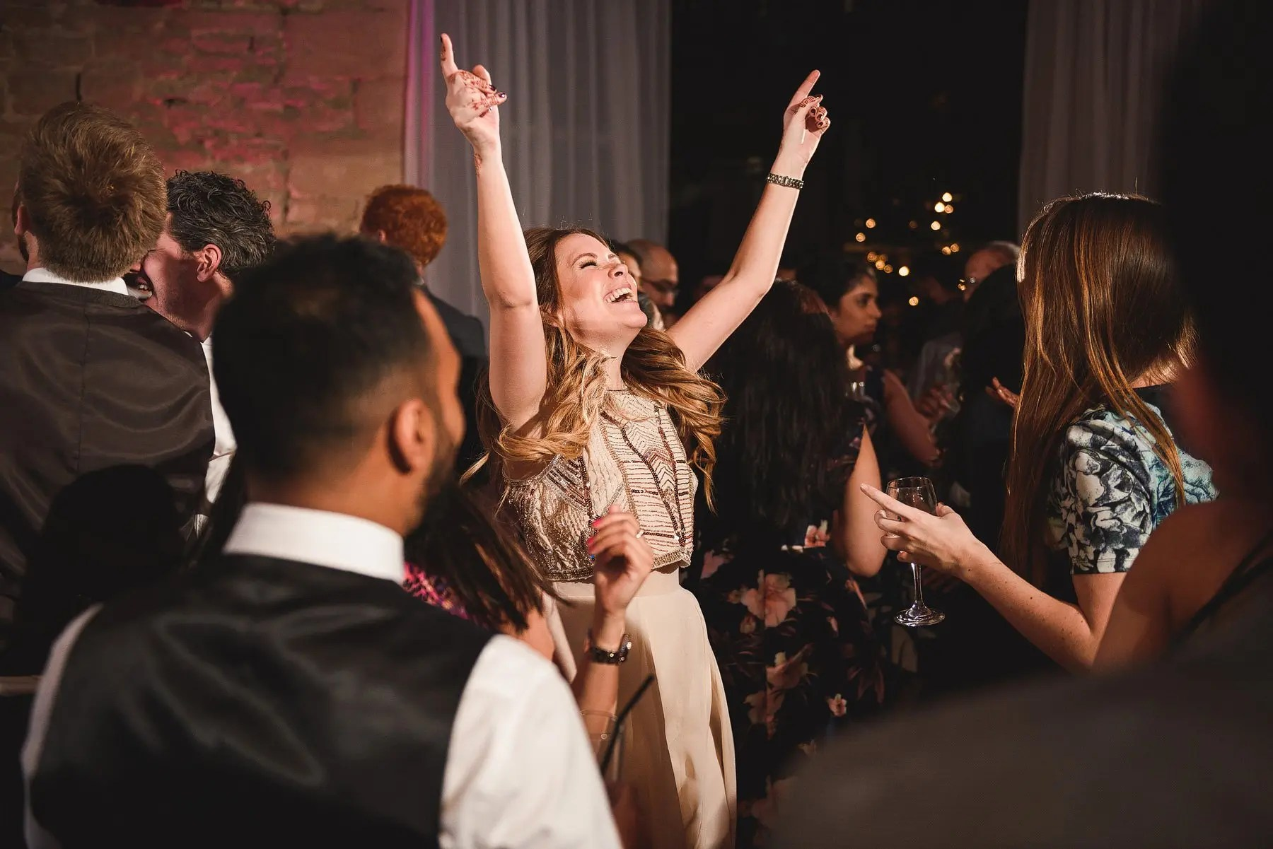bridesmaid dancing at a wedding
