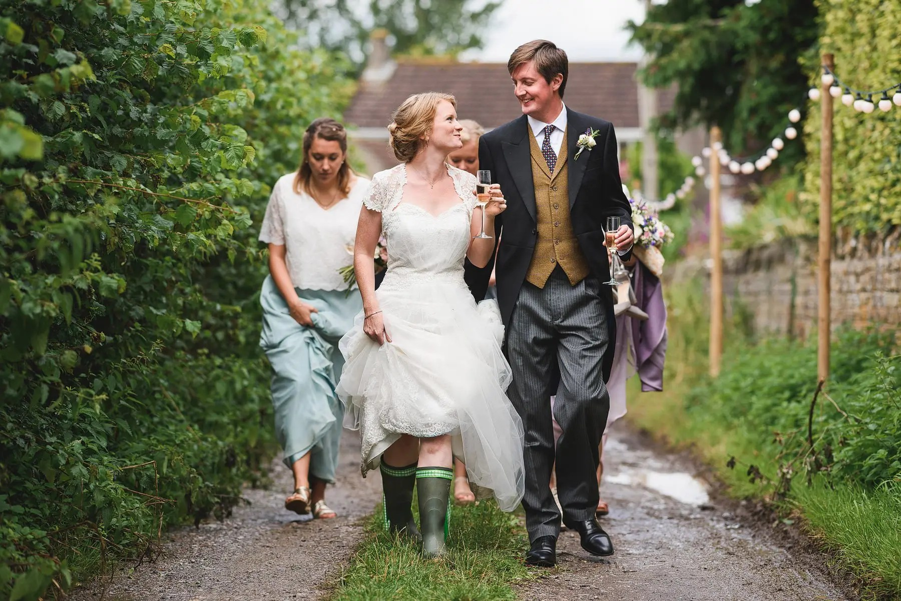 bride wearing wellies at her wedding