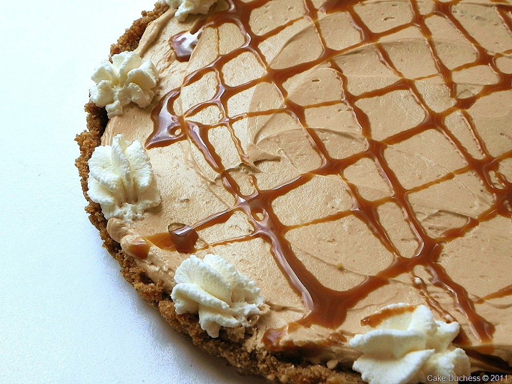 overhead image of peanut butter pretzel tart with caramel drizzle