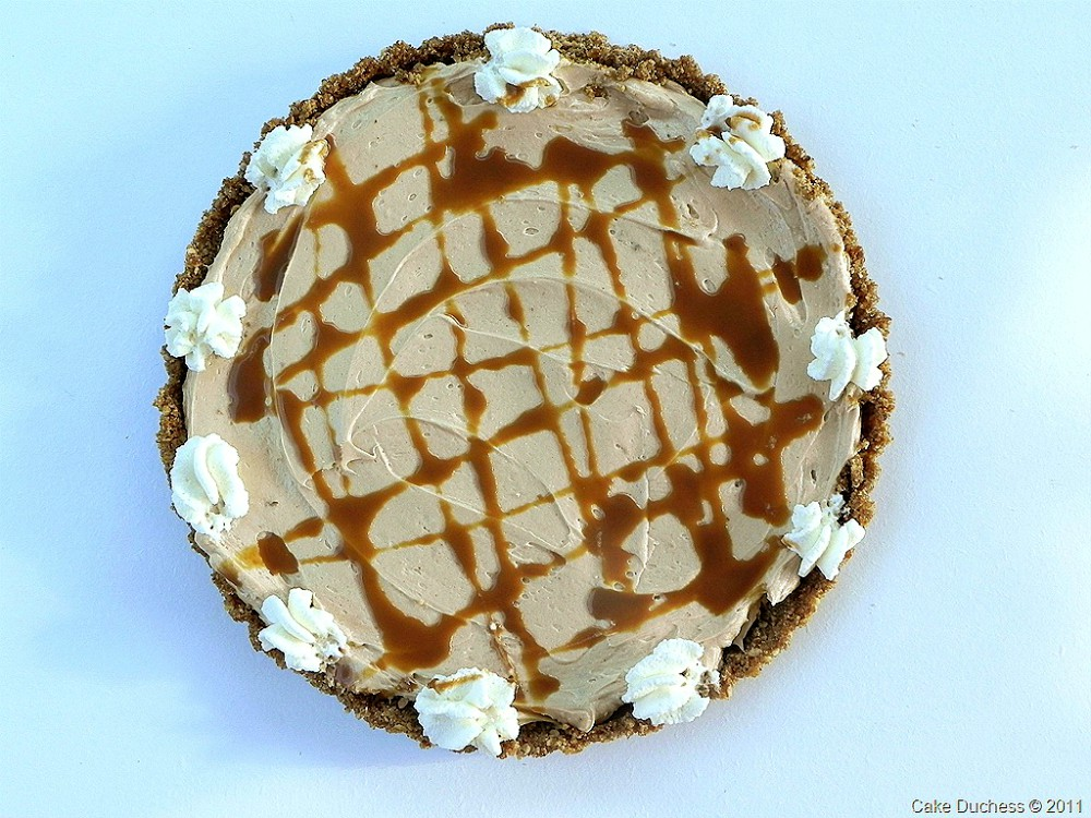 overhead image of peanut butter tart with caramel drizzle
