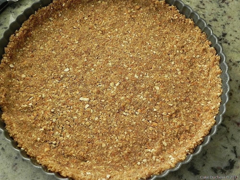 overhead image of crushed pretzel crust in a pie pan