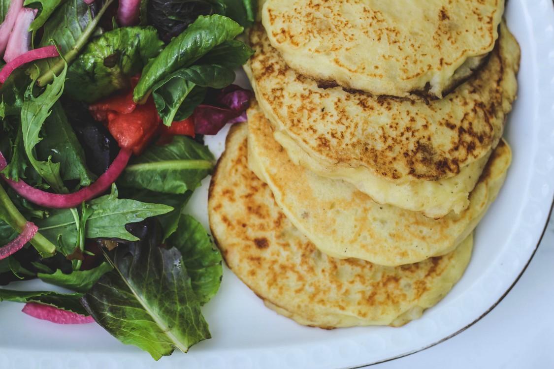 overhead image of potato pancakes and side salad