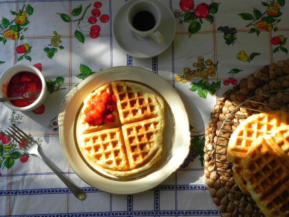 overhead image of overnight waffles on a colored tablecloth