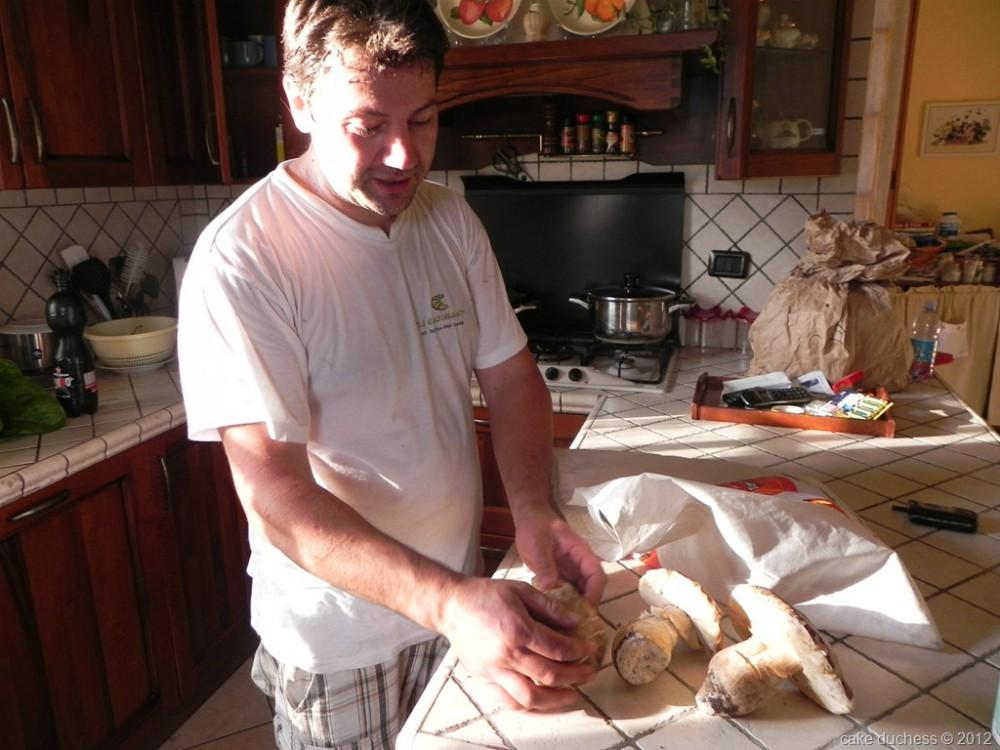image of man holding mushroom
