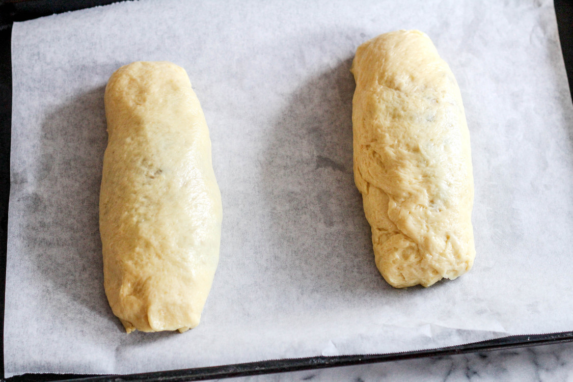 image of rolls of dough on parchment lined baking sheet