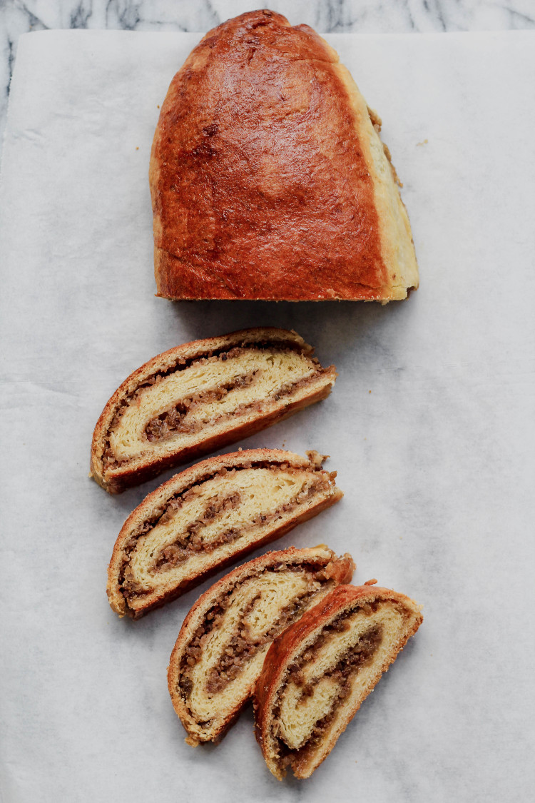 overhead image of sliced filled dough on parchment paper
