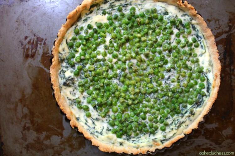 overhead image of ricotta tart with peas