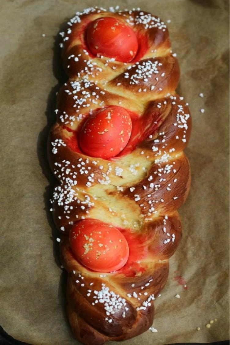 overhead imge of tsoureki greek easter bread on a baking sheet