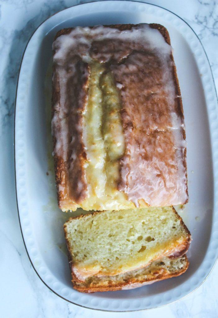 This lemon yogurt cake with is super moist, bursting with lemony flavor and a delicate crumb. This cake and a great cup of coffee is the perfect way to start your day. #baking #cake #lemonyogurtcake #lemoncake #italiancake #breakfast #coffeecake #dessert #teacake #afternoontea #snackcake #citrus #lemondessert