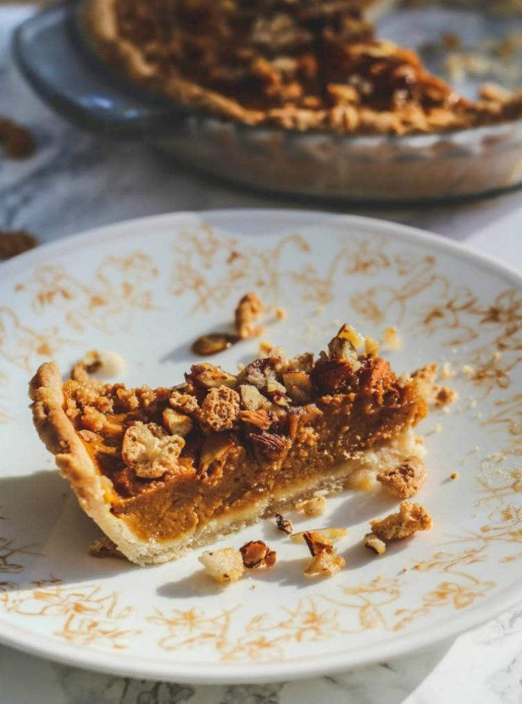 overhead image of slice of pumpkin pie