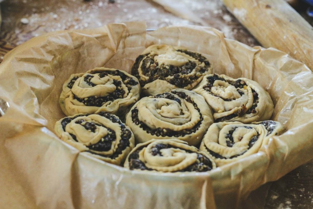 overhead image of fruit filled pastries in parchment lined pan