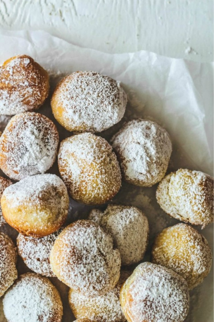 overhead image of round balls of dough with powdered sugar
