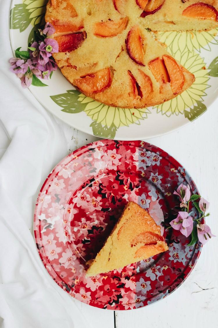 overhead image of peach polenta cake
