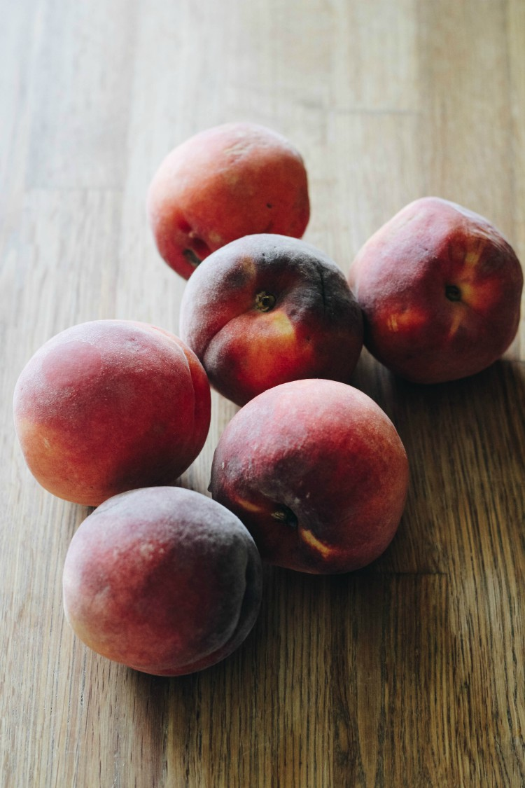 image of peaches on a wooden board