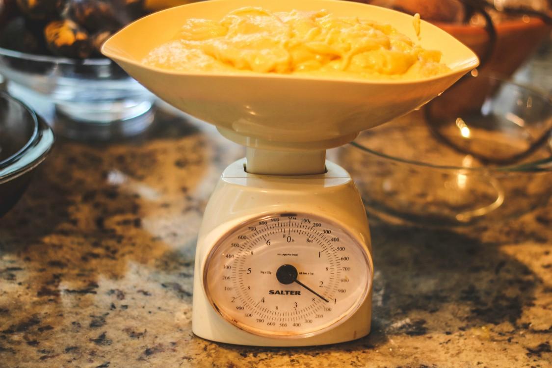 overhead image of dough on baking scale
