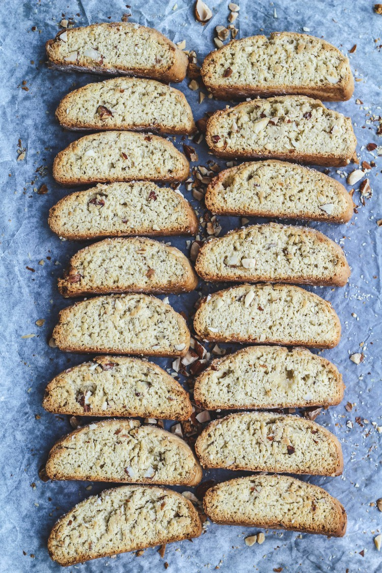 over head image of biscotti with nuts on baking tray