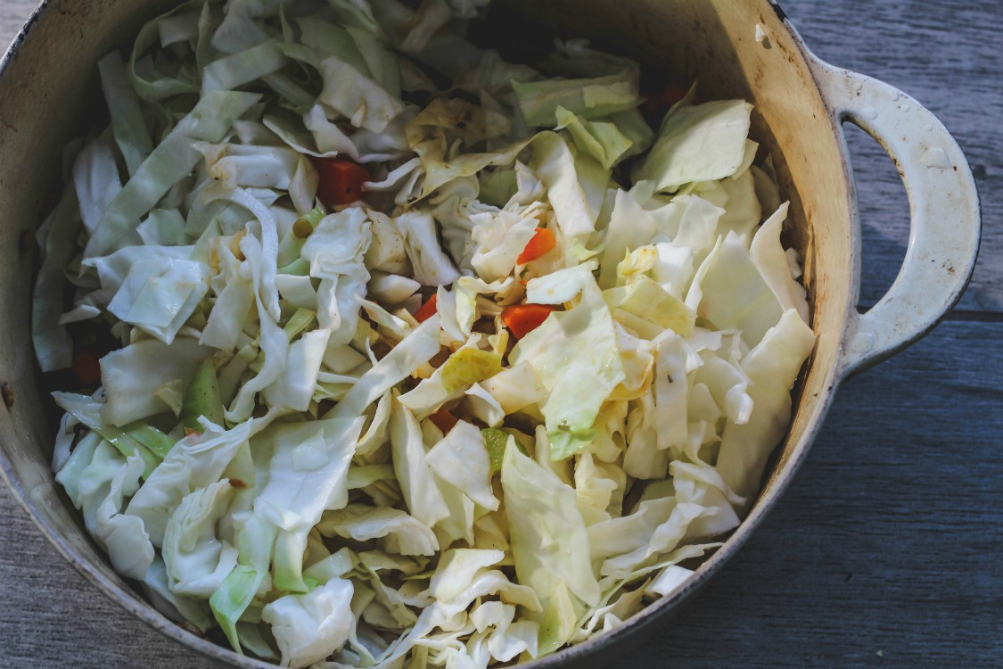 overhead image of cabbage in cast iron pot