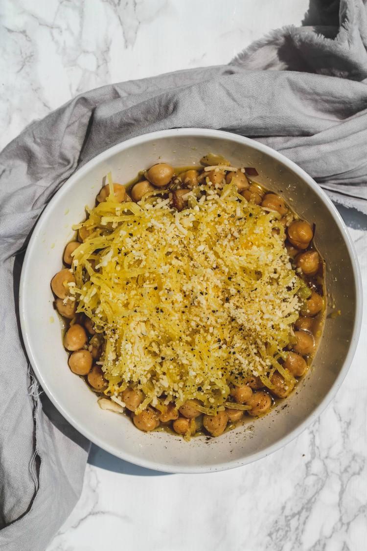 overhead image of cacio e pepe spaghetti squash with chickpeas