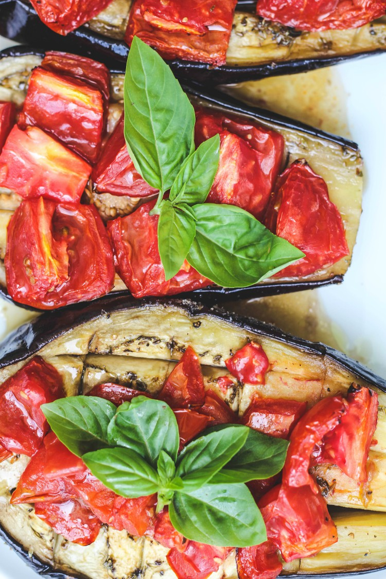 overhead image of sheet pan eggplant and tomato bake on a white plate