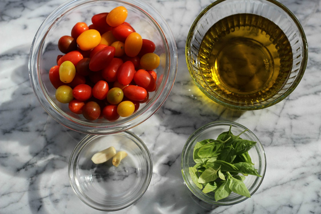 overhead image of making cherry tomato confit