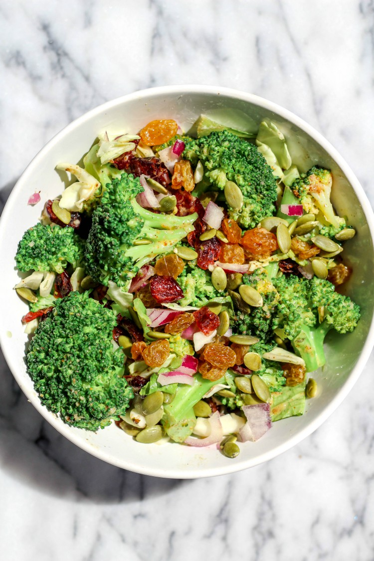 overhead image of whole30 broccoli salad in a white bowl